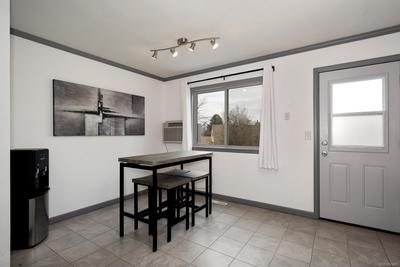 Roomy eat-in kitchen with access to deck and backyard.