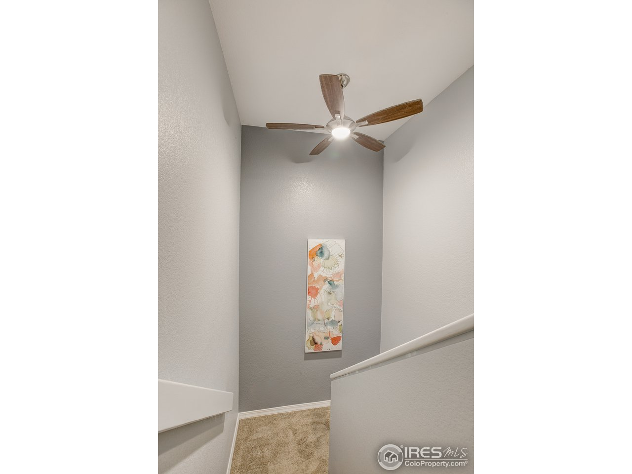 Stairway w/Ceiling Fan for added Circulation