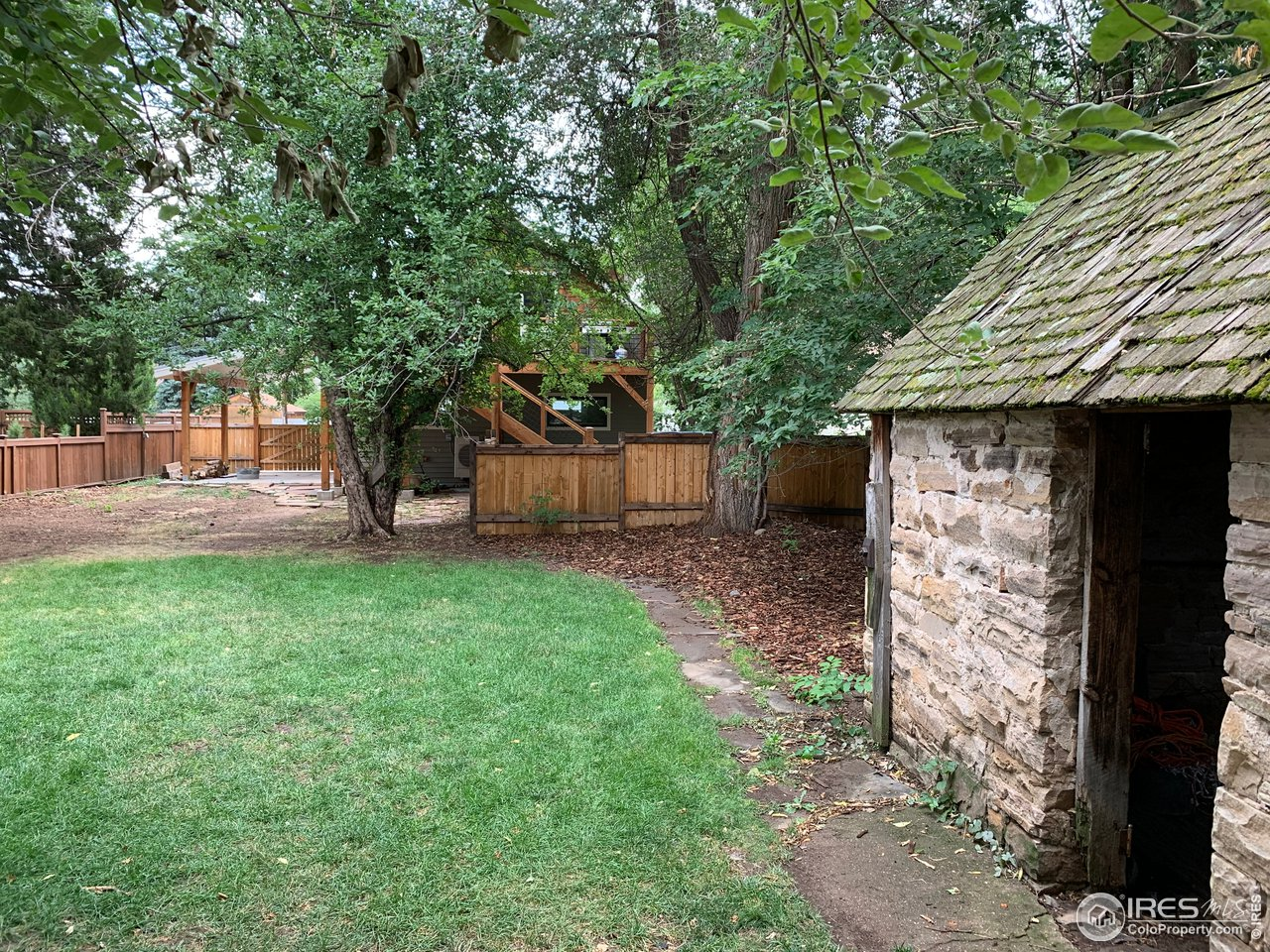 Large mature yard with lots of character and charm