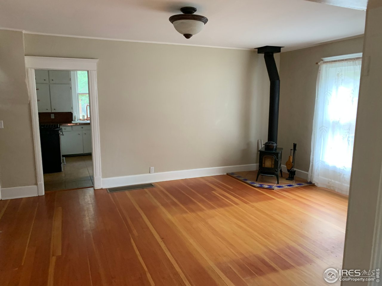Photo when vacant to show amazing hardwoods in main house