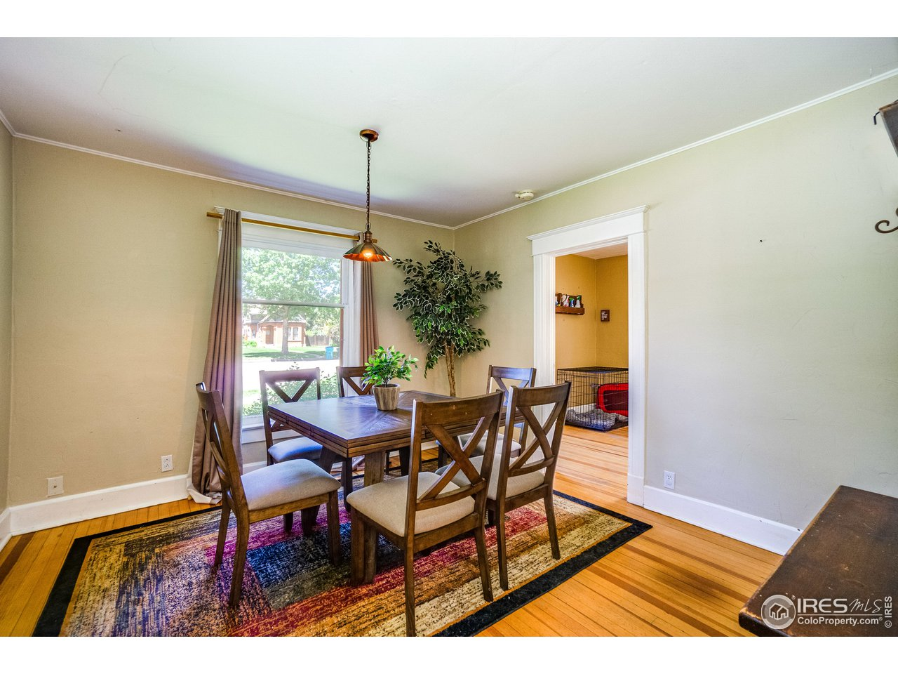 Main house dining room with wood floors