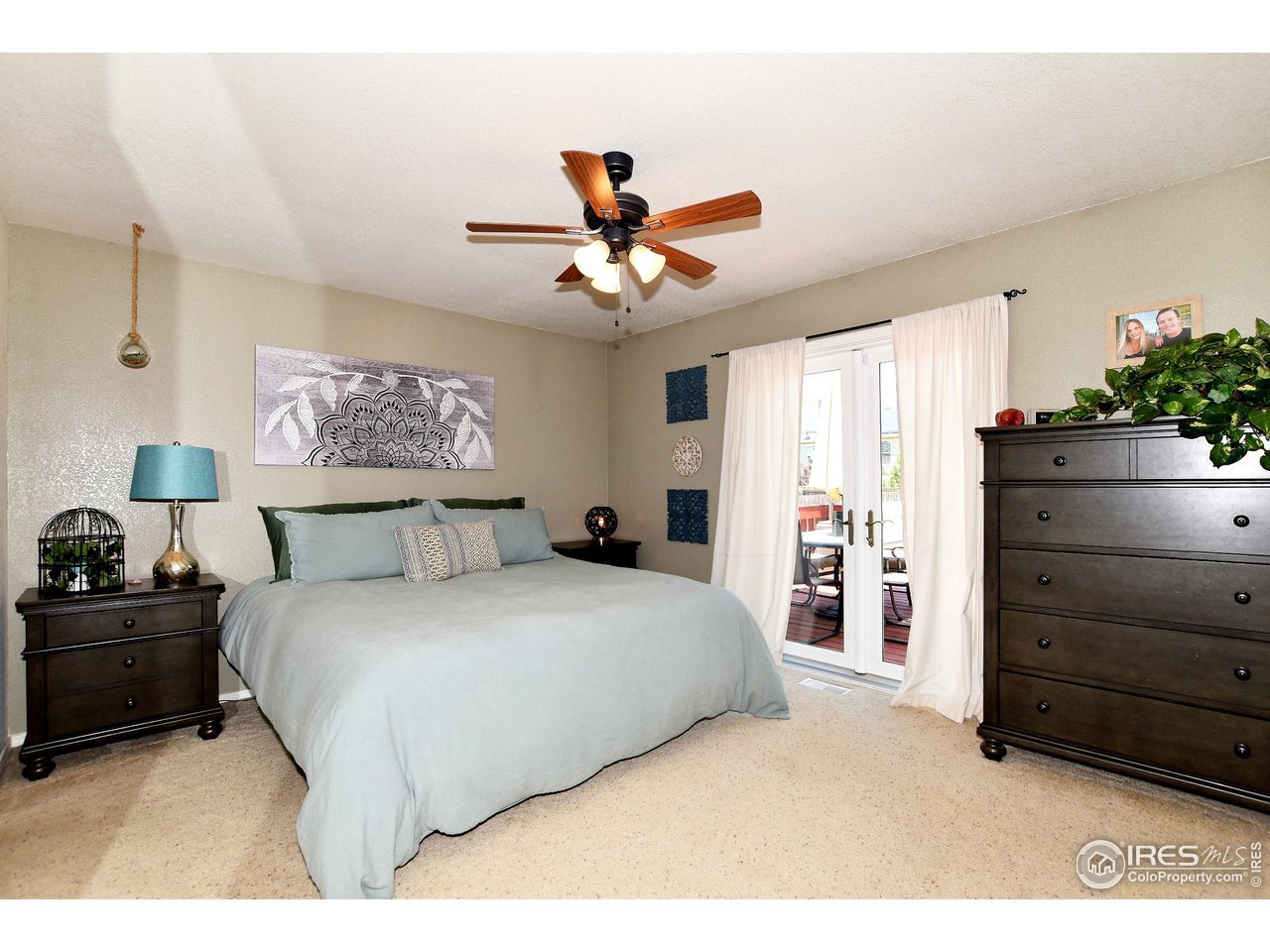 Main Level Owner's Bedroom with French Doors to Deck