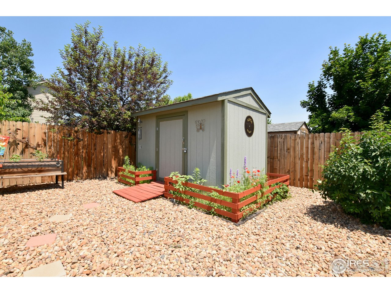 10' X !2' Out building with Ramp, surrounded by flower beds