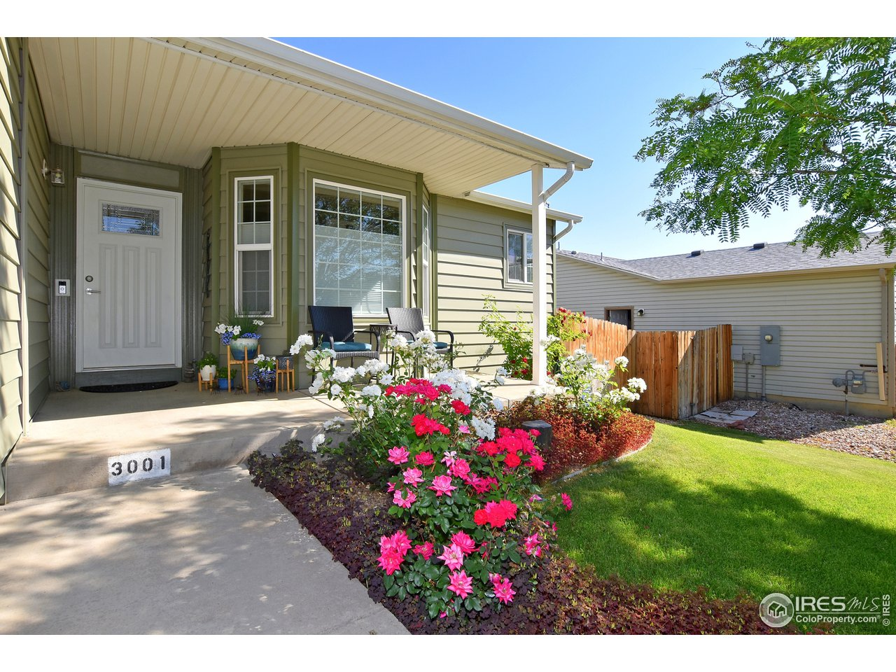 Enjoy coffee on the Beautiful Covered Front Porch while you smell the Roses
