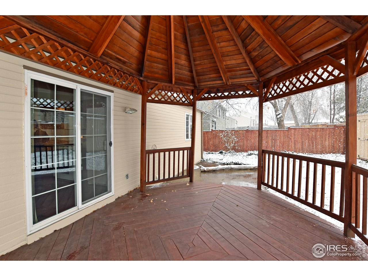 Right off the Kitchen is this enormous covered deck!