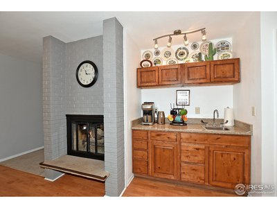 Gas log fireplace and wet bar