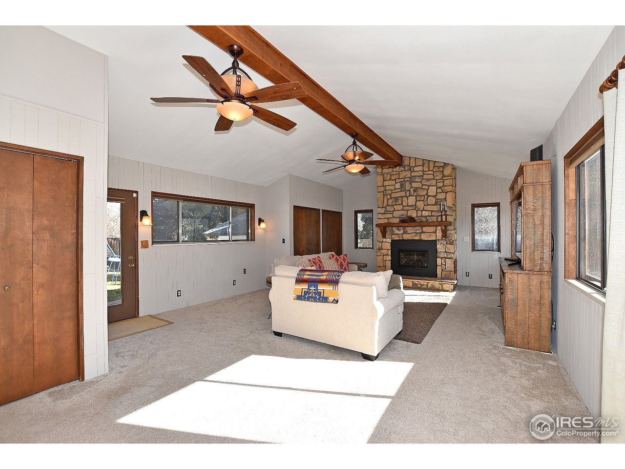 Very large family room w/beam & gas log fireplace