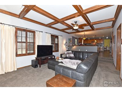 Family room with exposed beams