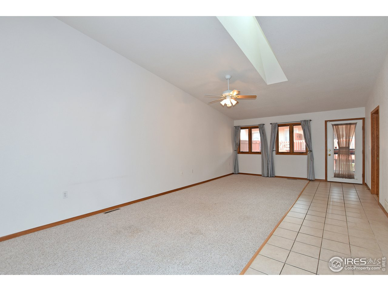 Dining room is 14'X10' - vaulted ceiling