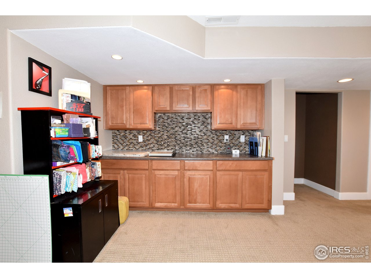 The family room also features built in cabinets and countertop