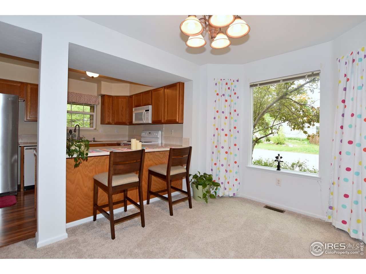 The dining room/nook area also features a breakfast bar into the kitchen.