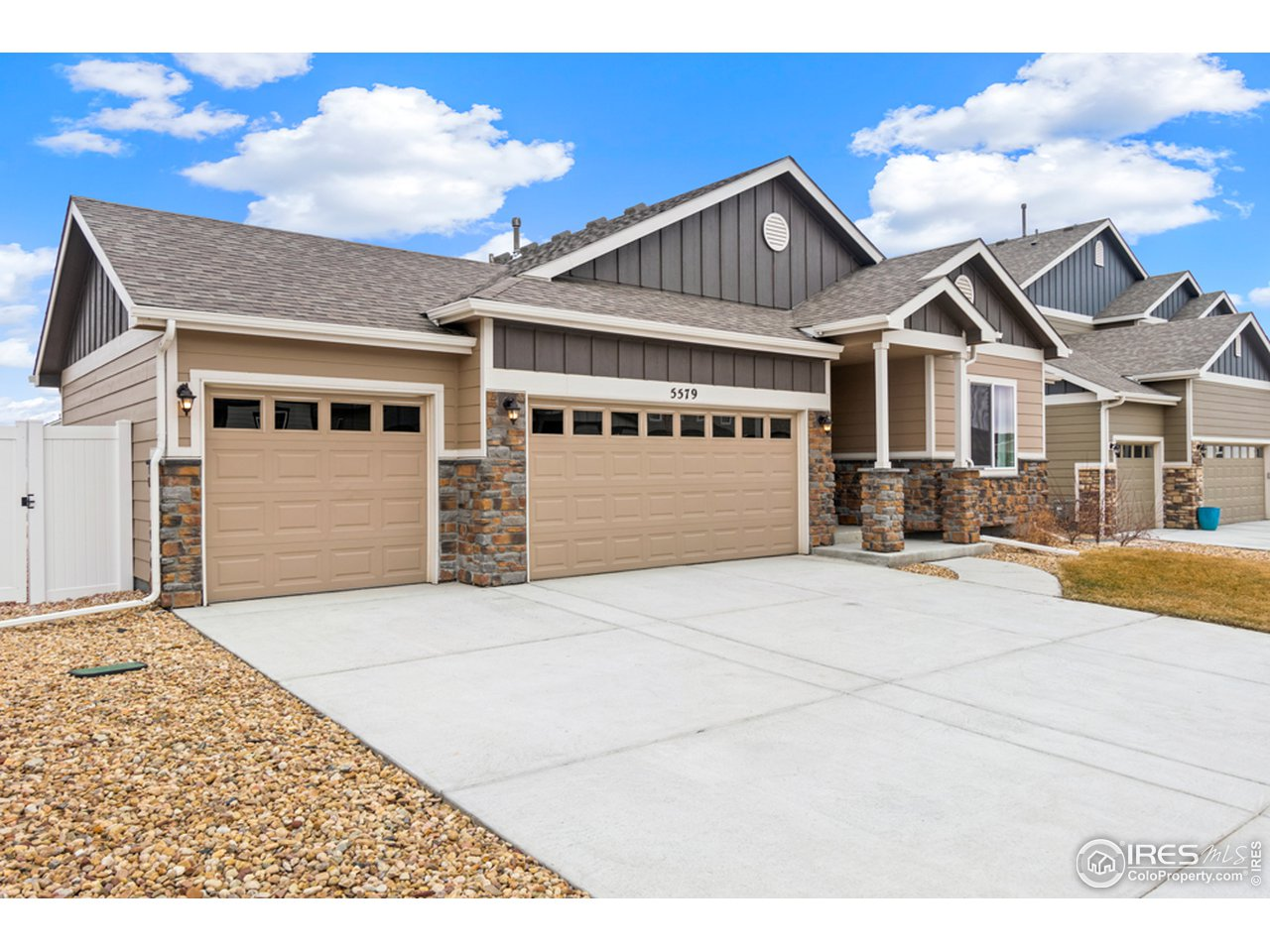 Three car garage, with door to back yard and extra concrete pad at backdoor.
