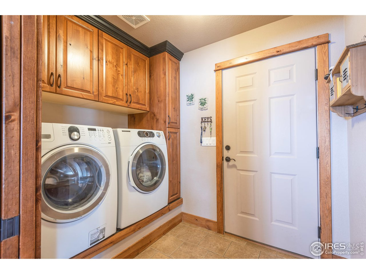 Laundry with custom cabinets
