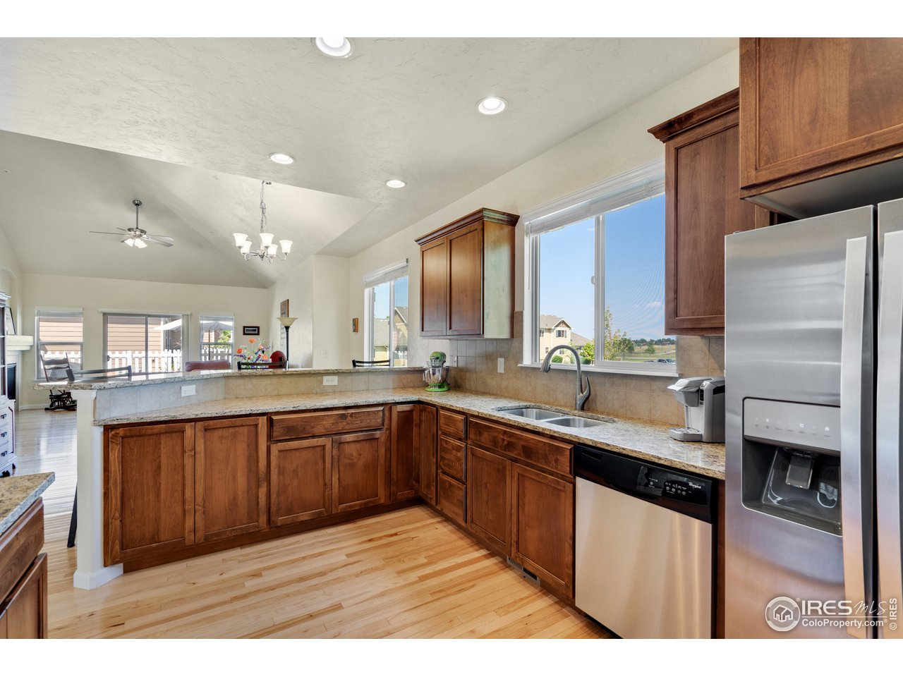 stainless appliances ,  kitchen window looks out to the park