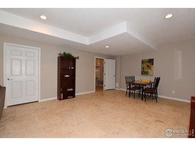 Travertine tile floor throughout basement.
