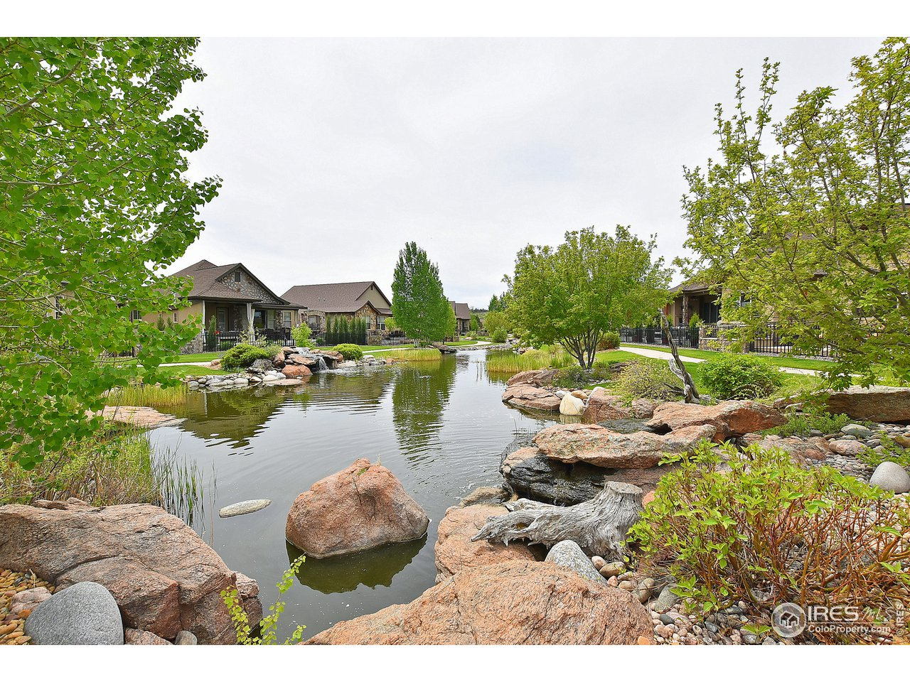 Home backs to private pond and waterfall.