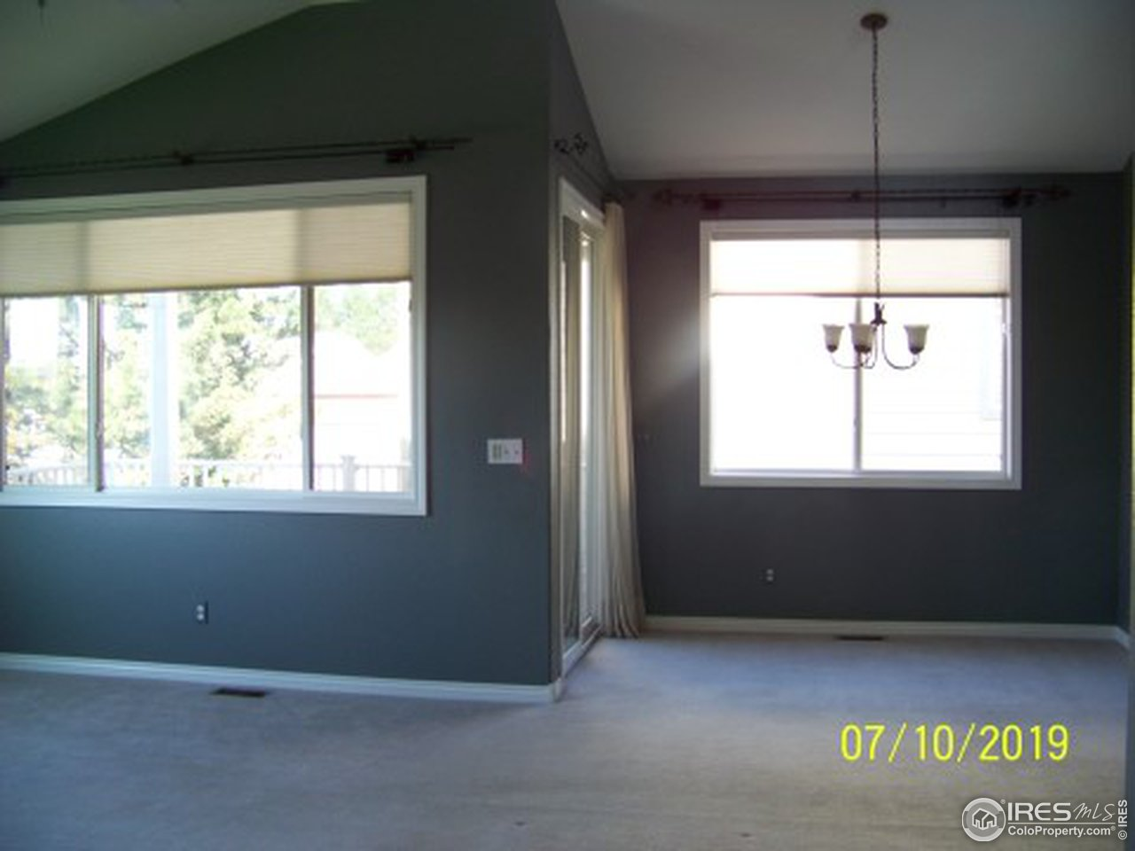 Spacious Formal Dining has sliding door to deck