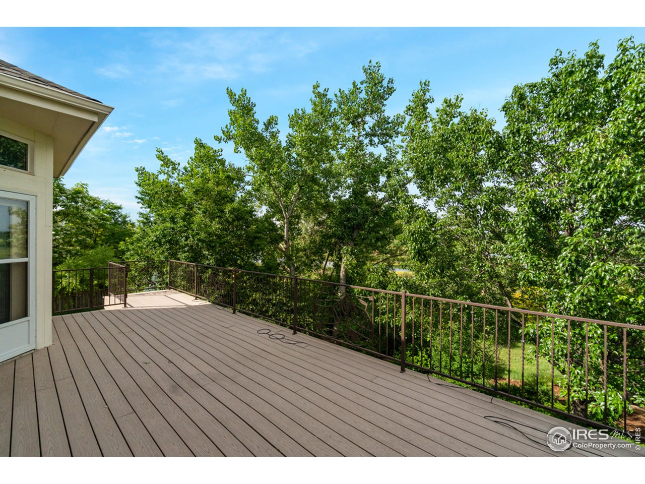 Large Deck with Artistic Iron Railing
