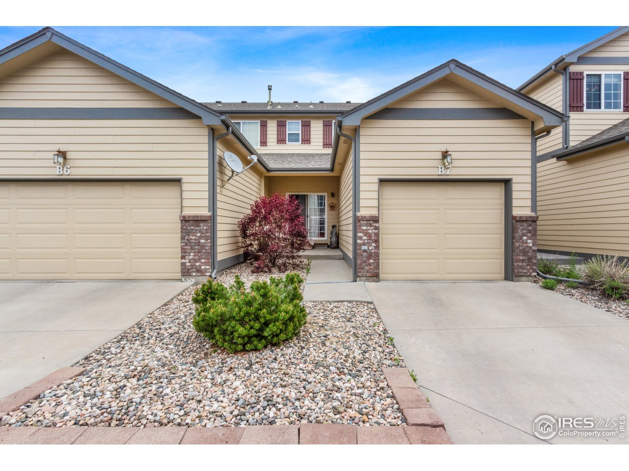 Back patio, entrance, attached garage.  Guest parking lot just steps away!