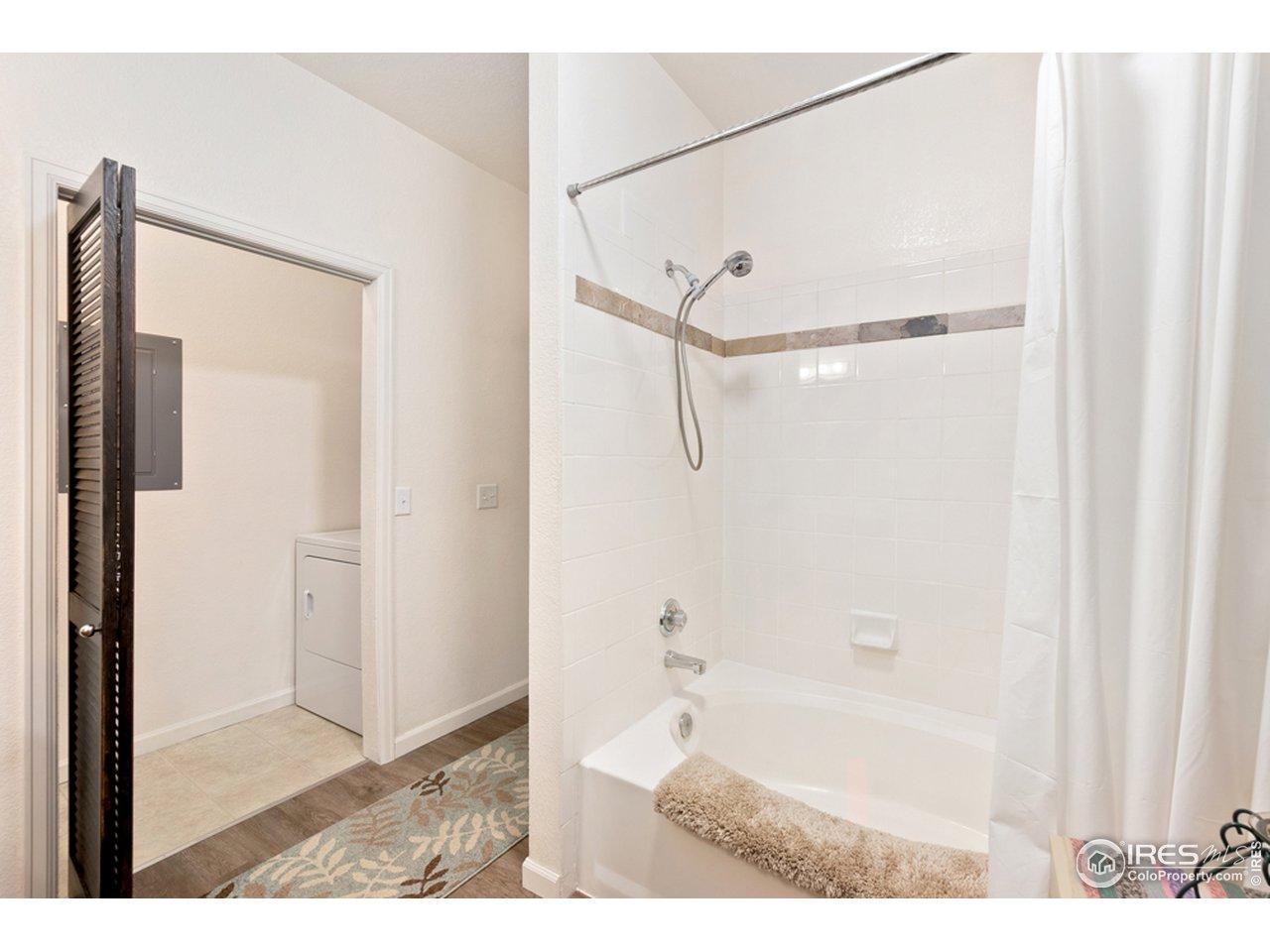 Large full bath/laundry area.