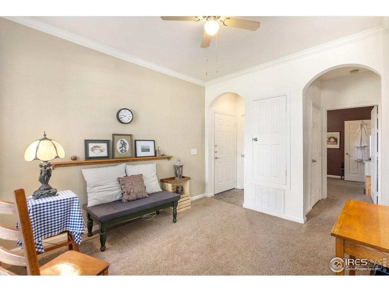 Spacious, open living room; arches, crown molding, 9 ft ceilings