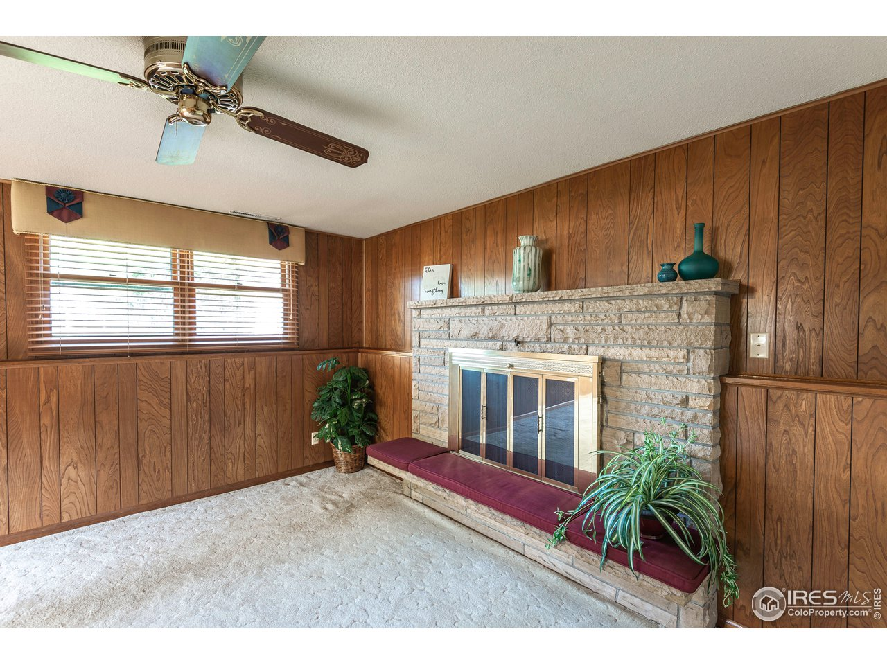 Stone fireplace located on the lower level