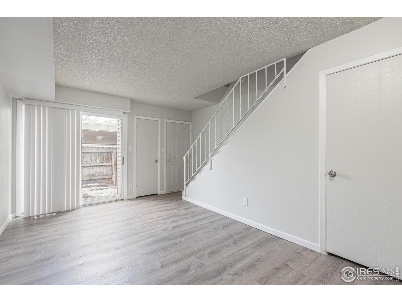 Walk-in closet for additional storage located under the stairs