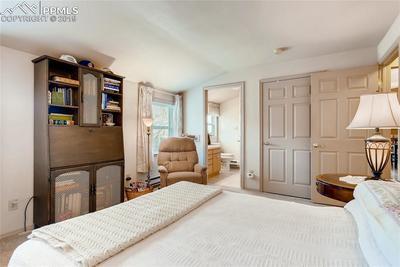 Main level bedroom w/wide door to bath, lots of storage and bath walks out to de