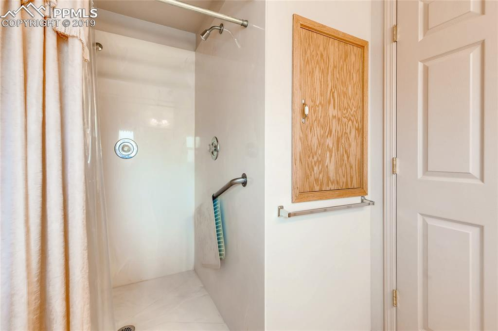 Thoughtful storage and easy access, big shower off mail level bedroom
