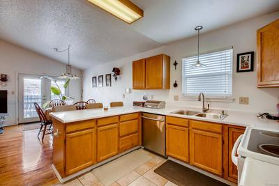 Bright and functional kitchen is open to the family room and breakfast nook