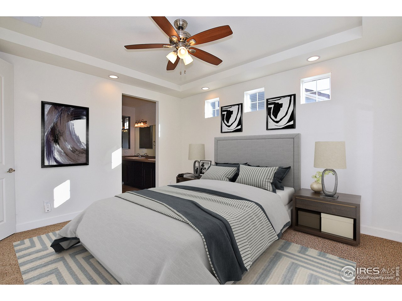 Light filled master with tray ceilings!