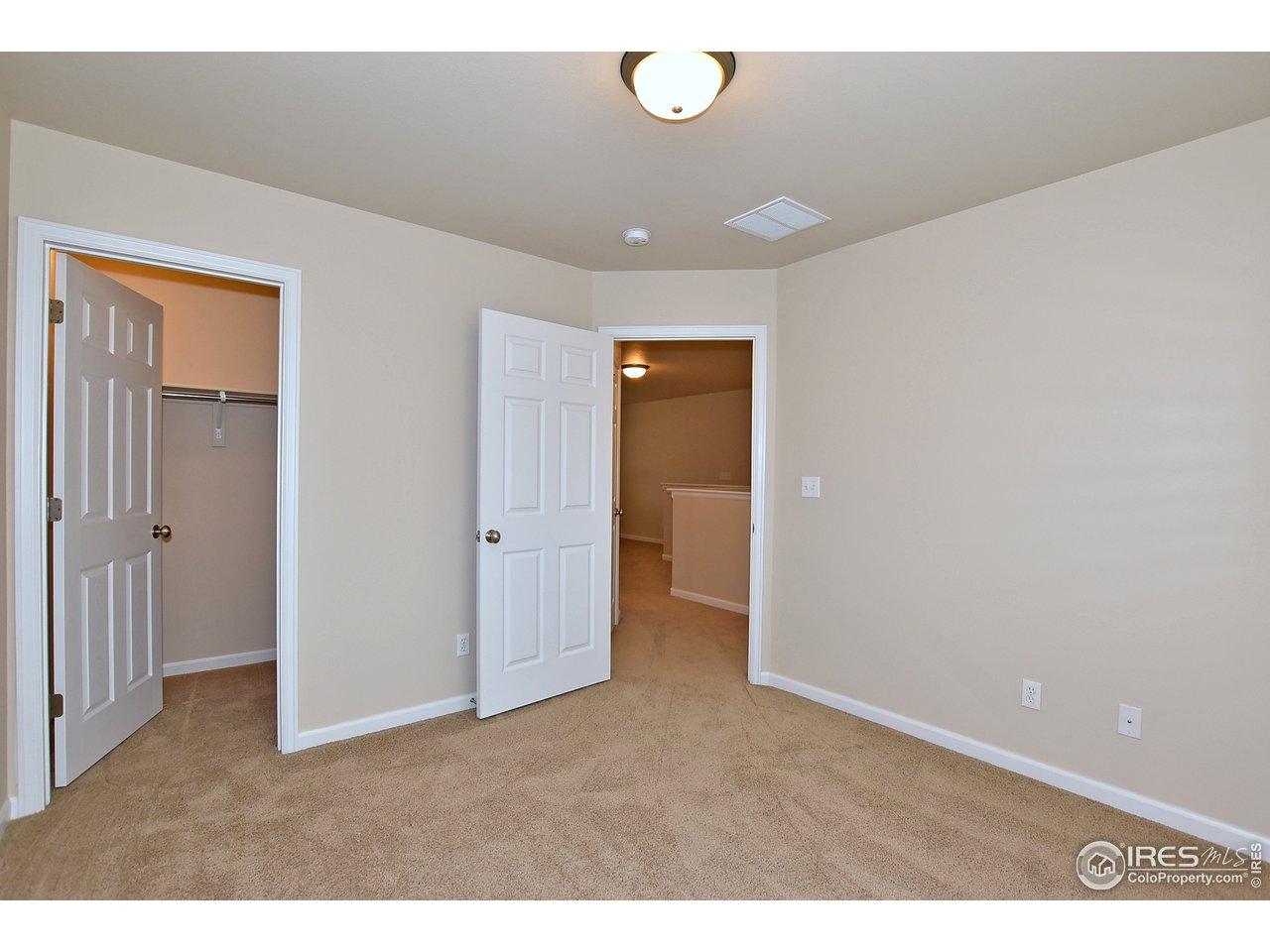 3rd upstairs bedroom w/ walk in closet