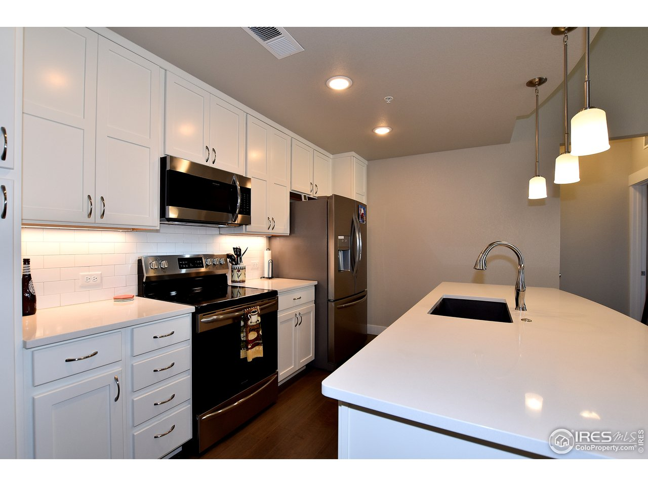 Upgrade white cabinetry and spacious island
