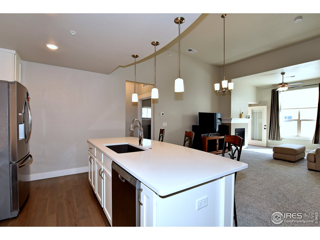 Kitchen overlooking great room and dining area