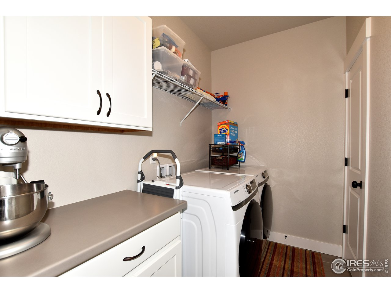 Oversized laundry room off of kitchen