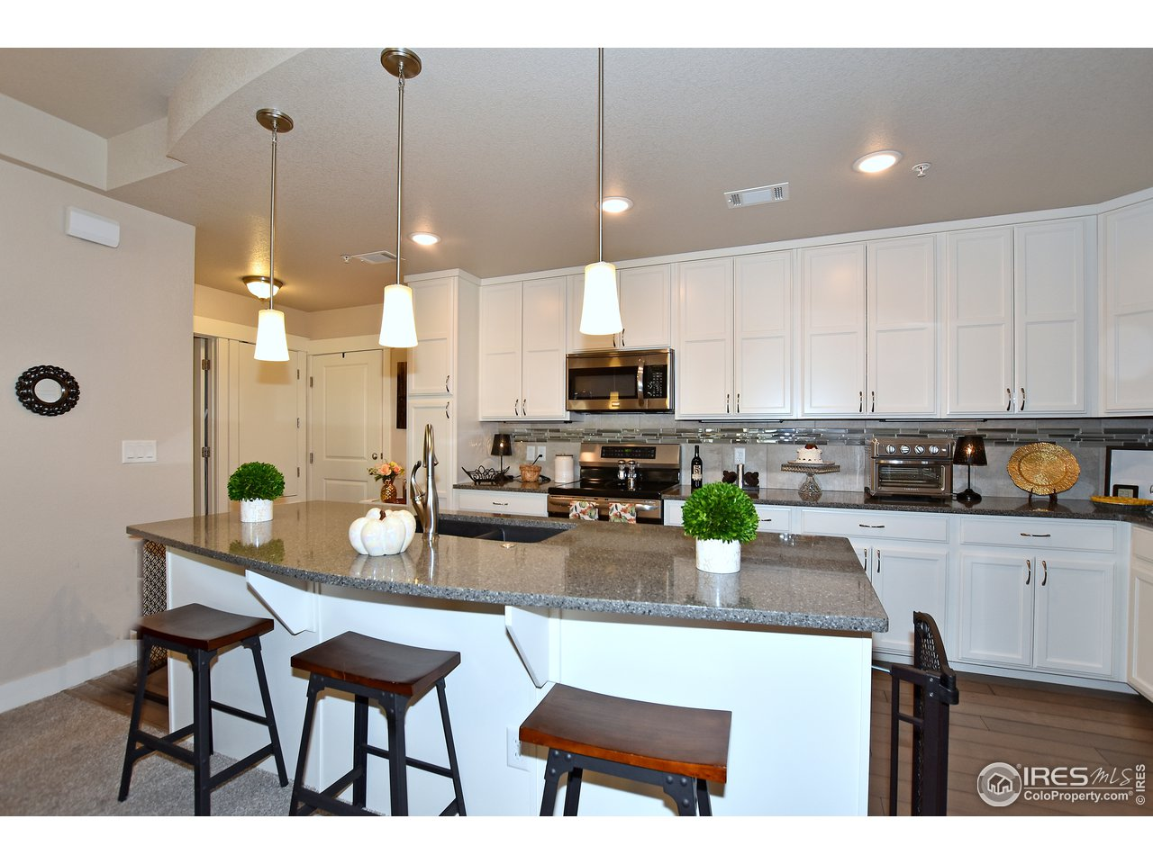 Large center island opens up to large dining and great room space