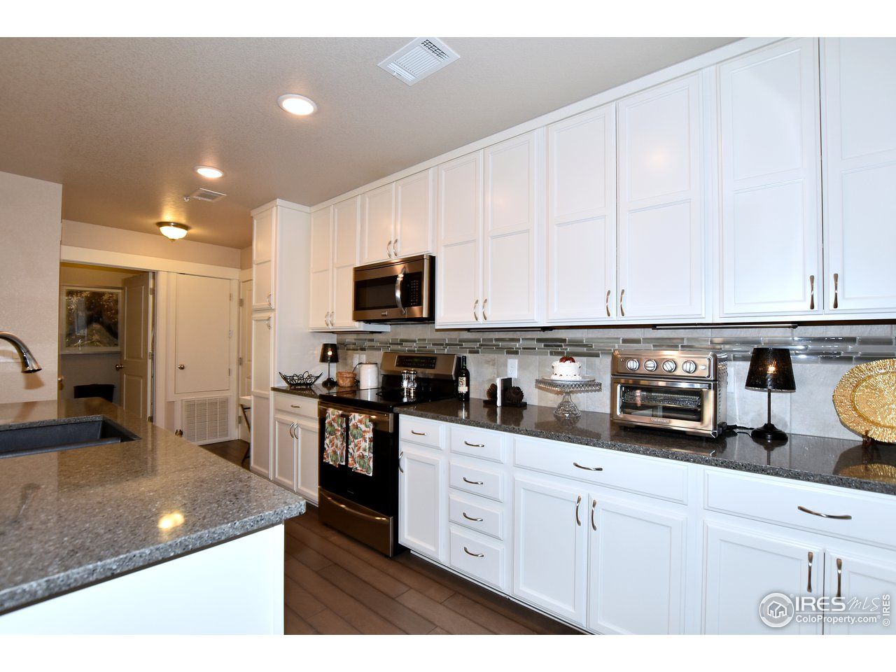 View back to front entrance and spacious laundry room