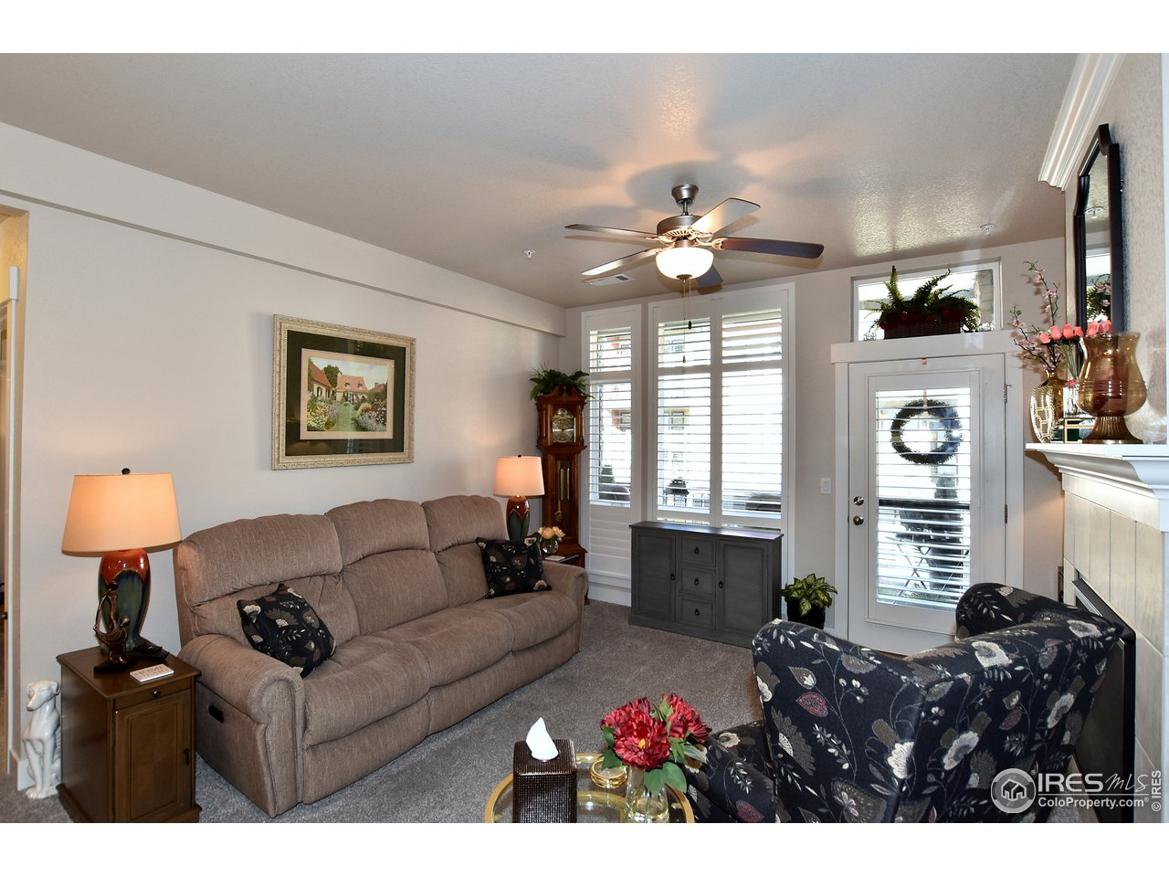 Spacious living area w/ door and storm door out to balcony to let loads of light in
