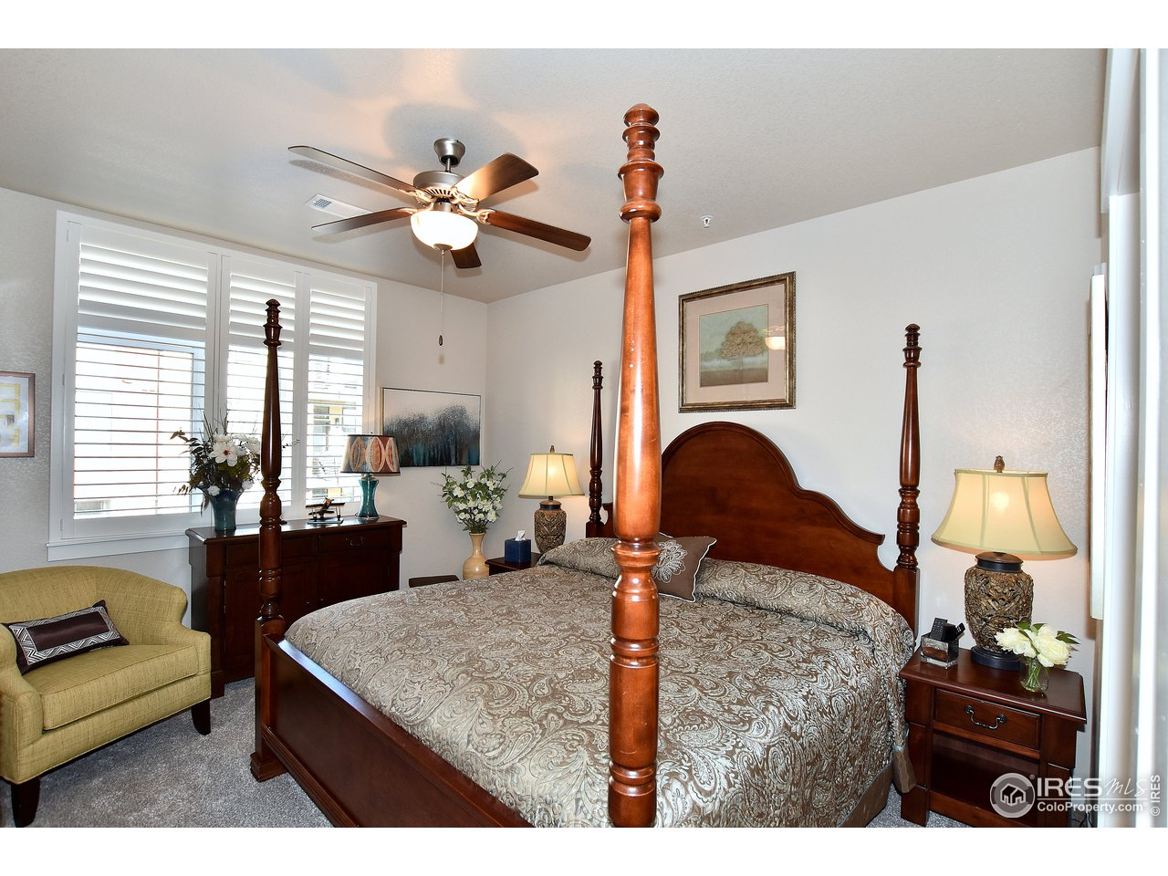 Spacious master suite with views of the front courtyard/gazebo