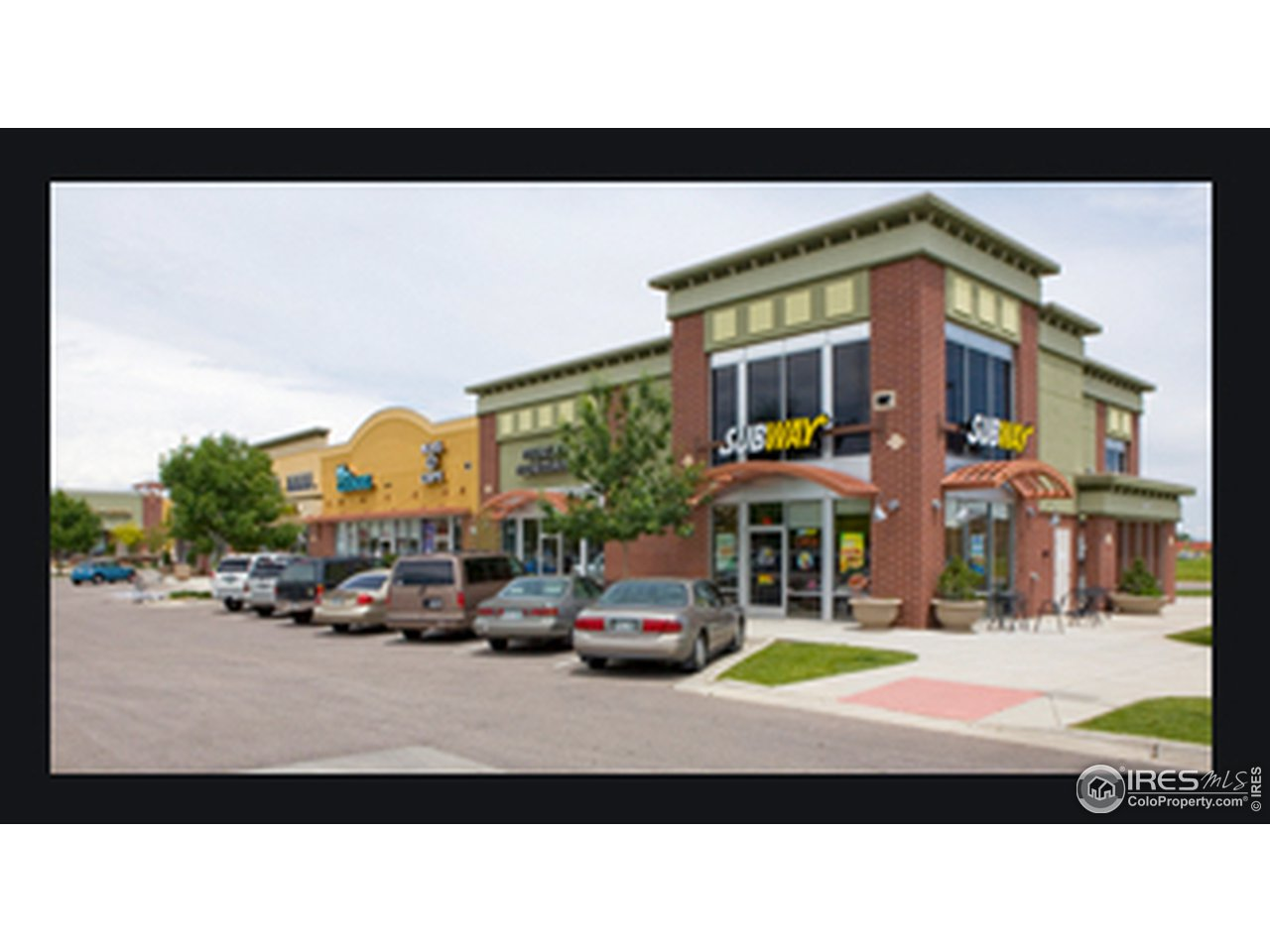 Shopping center literally steps away from unit including a grocery store!