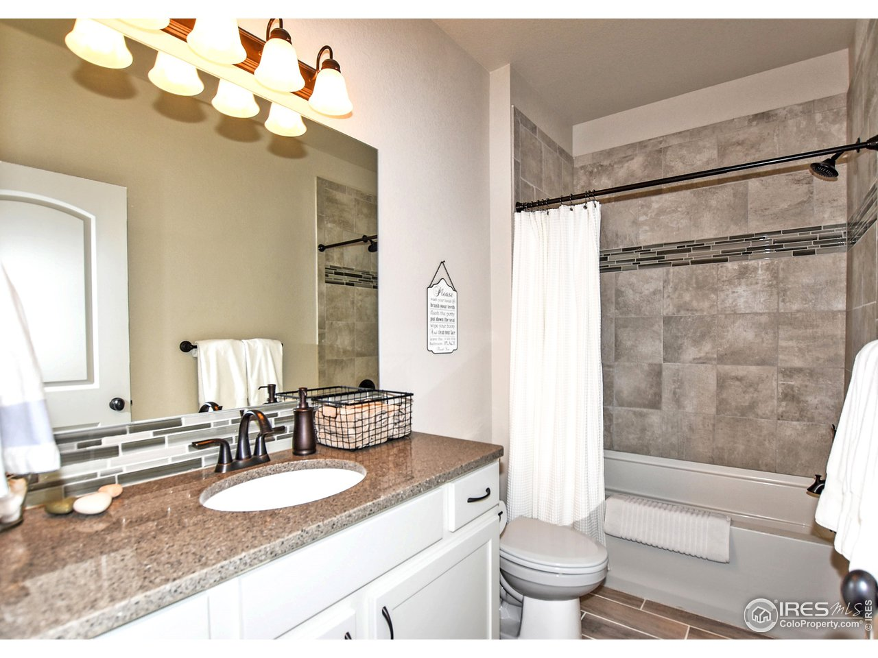 Shared upstairs full bathroom has upgraded quartz counters