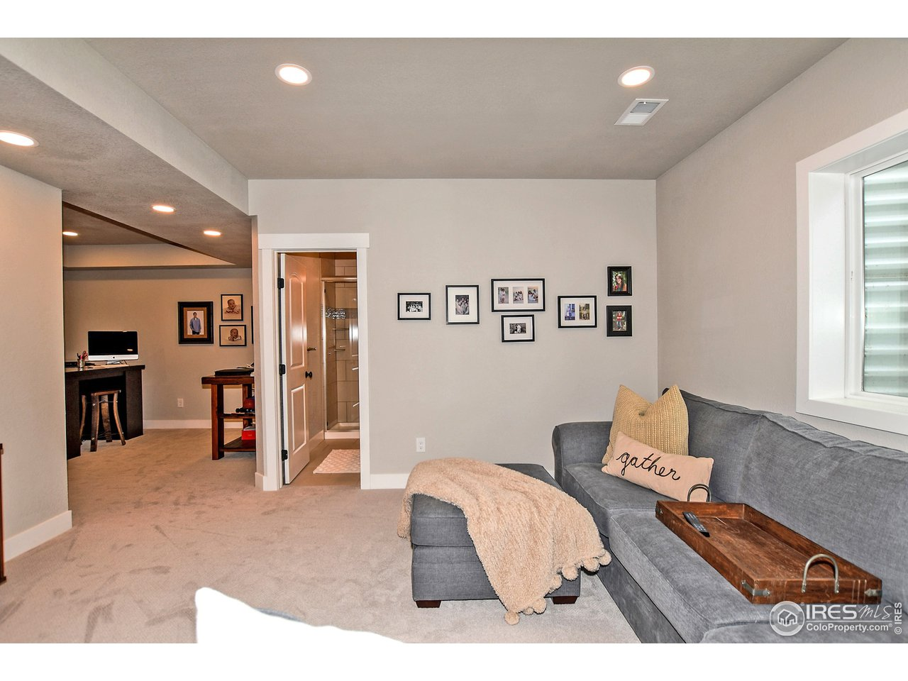 Fully encased windows, loads of lights and 9 ft. ceilings make this basement space feel grand
