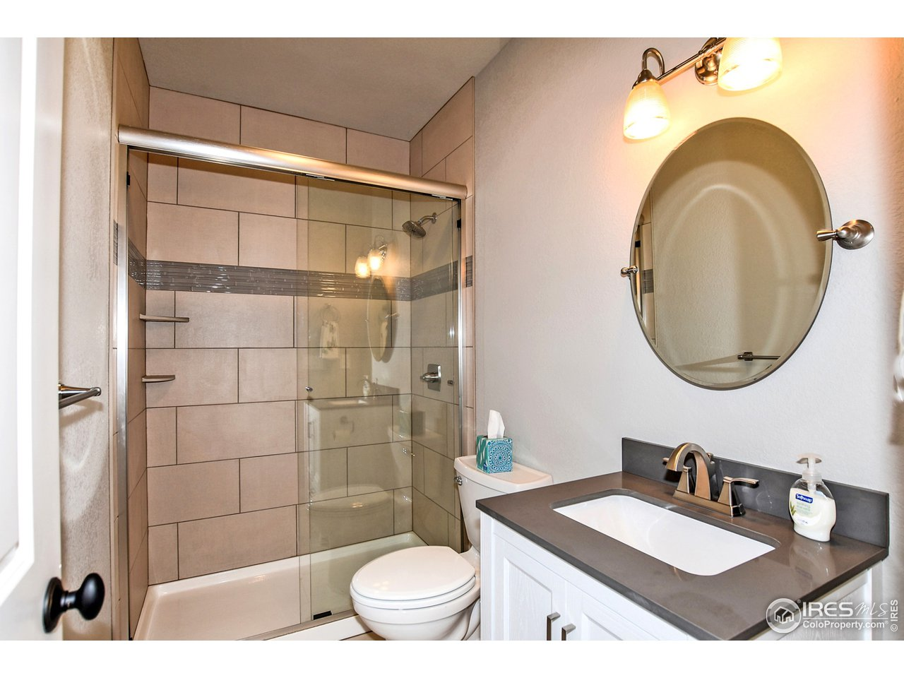 Great sized 3/4 bathroom attached to the 4th bedroom or additional living space.