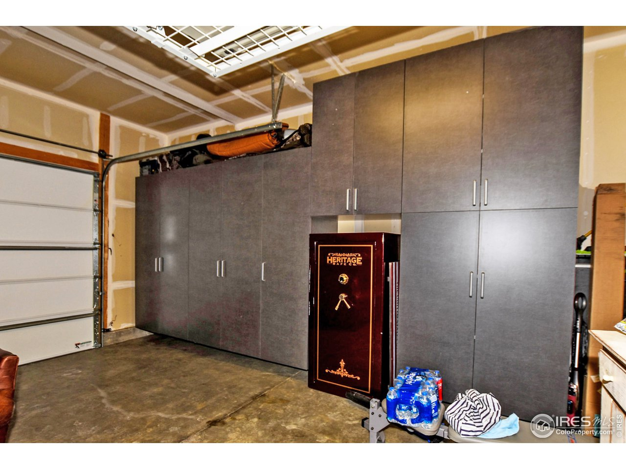 Custom storage cabinets in the oversized 2 car garage and safe are included in the sale of the home!