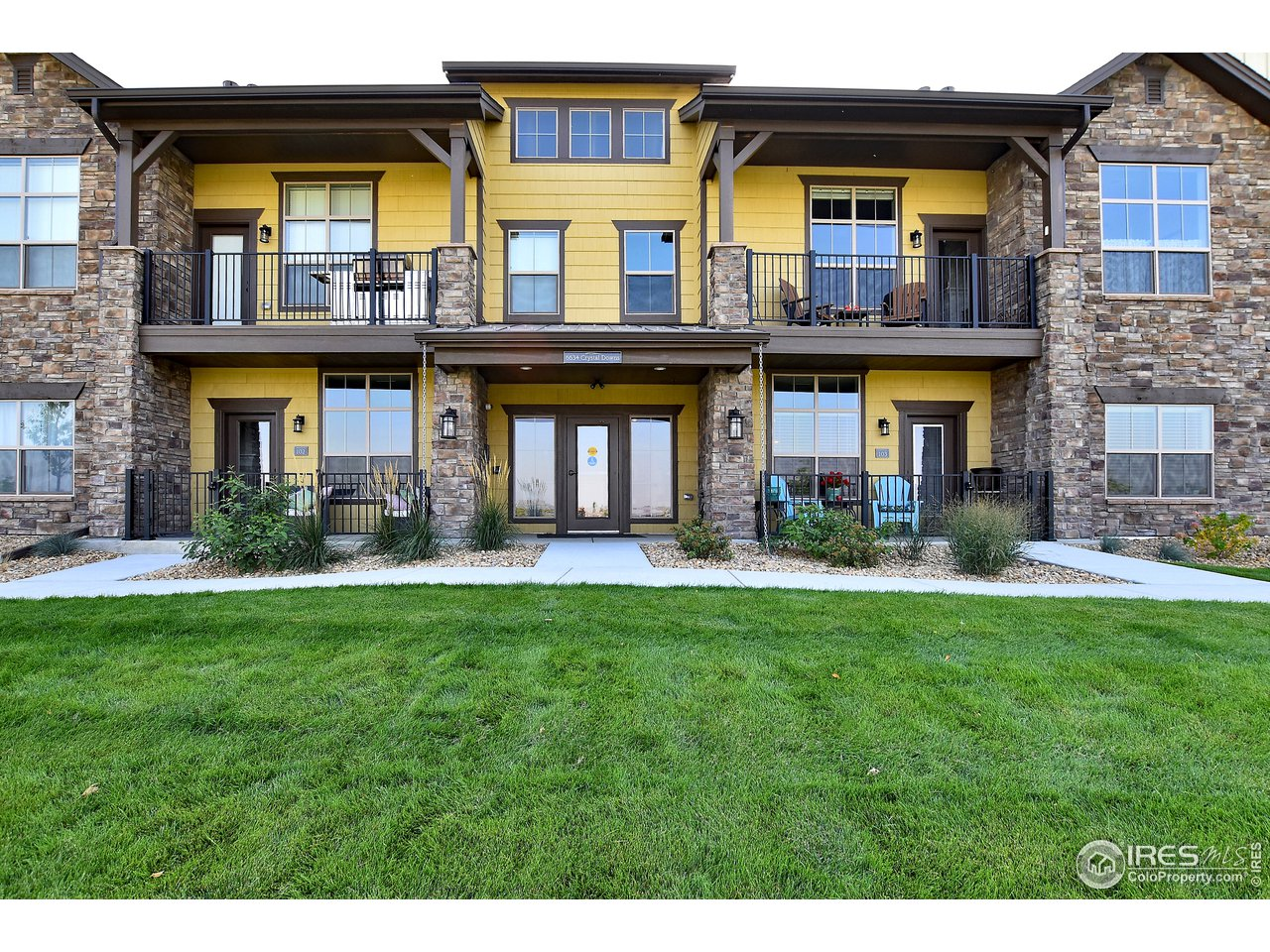 Welcome Home to Portofino Flats in coveted Highland Meadows Golf Course Community