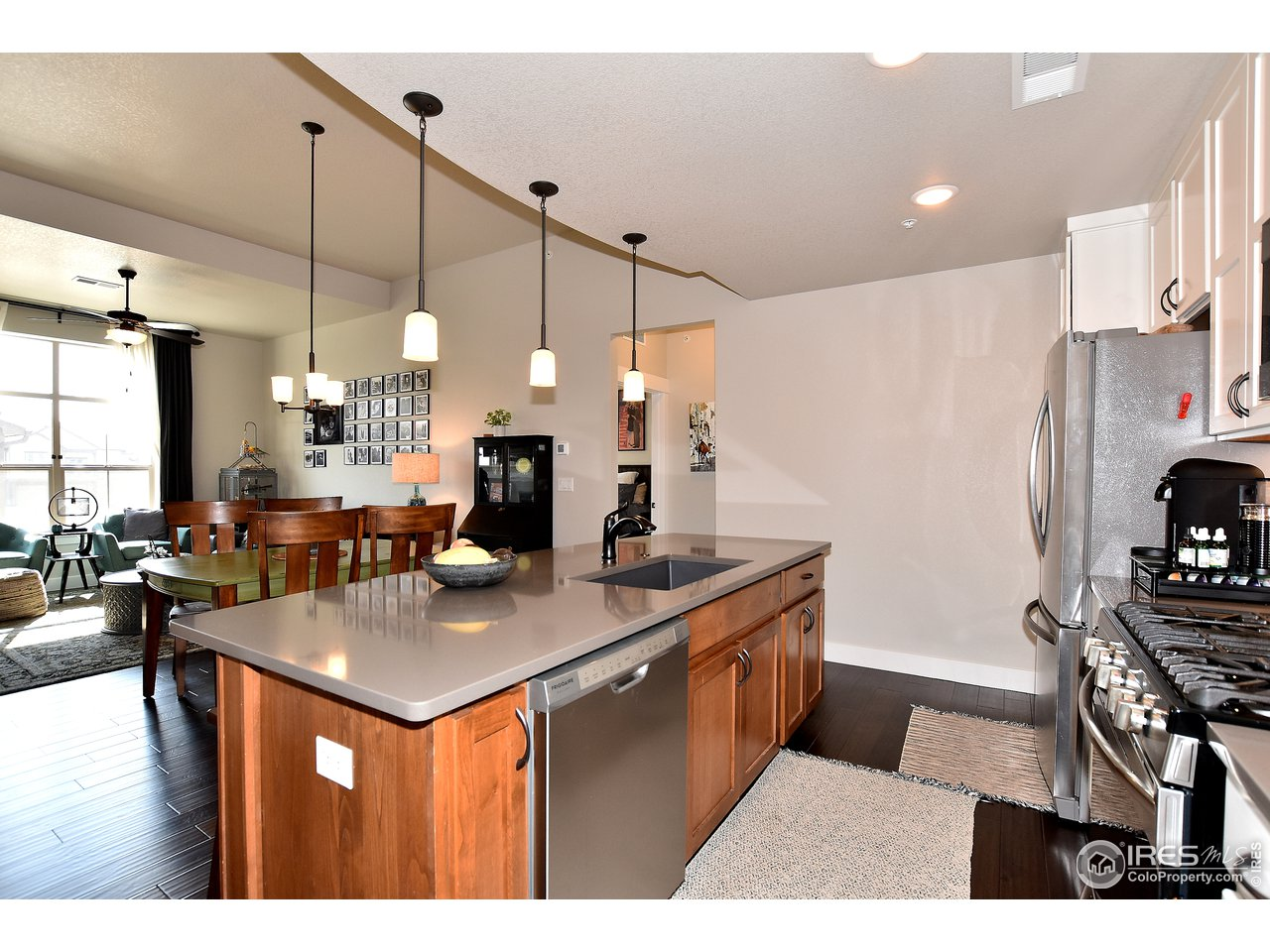 Perfect sized kitchen w/ quartz counters and upgraded granite composite sink and faucet