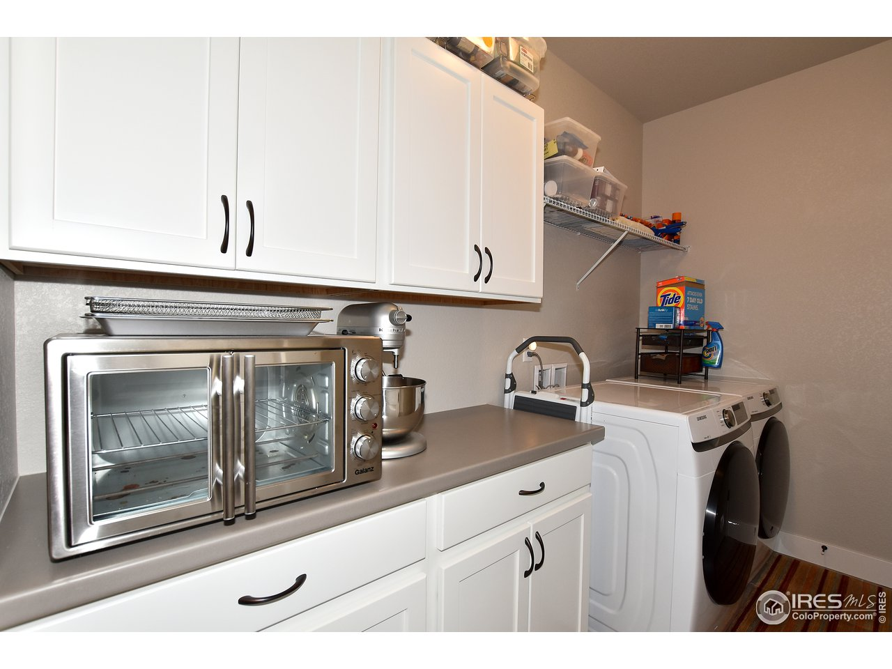 Oversized laundry room offers plenty of cabinetry and extra storage closet off of kitchen 1 yr. old washer and dryer are included!