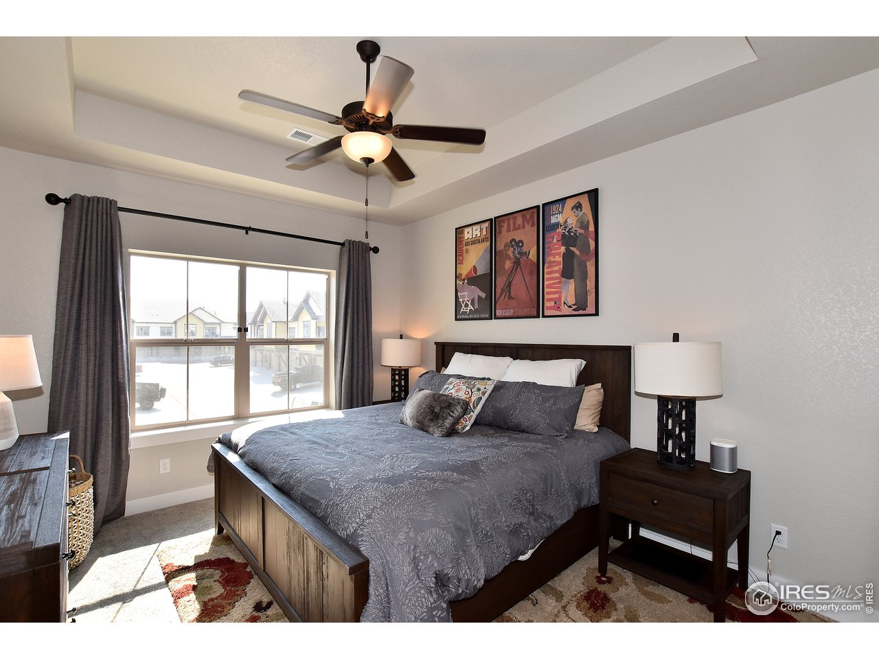 Spacious and bright main level Master Bedroom with coved ceiling and ceiling fan for extra comfort