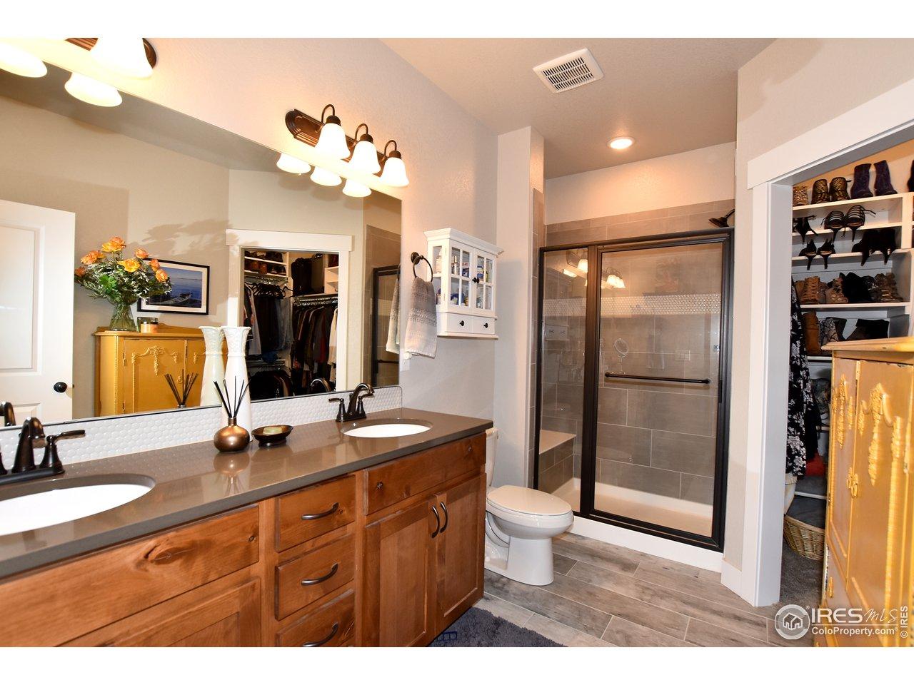 Spacious Master en-suite bathroom w/ oversized shower, walk in closet and double vanities w/ upgraded quartz counters!