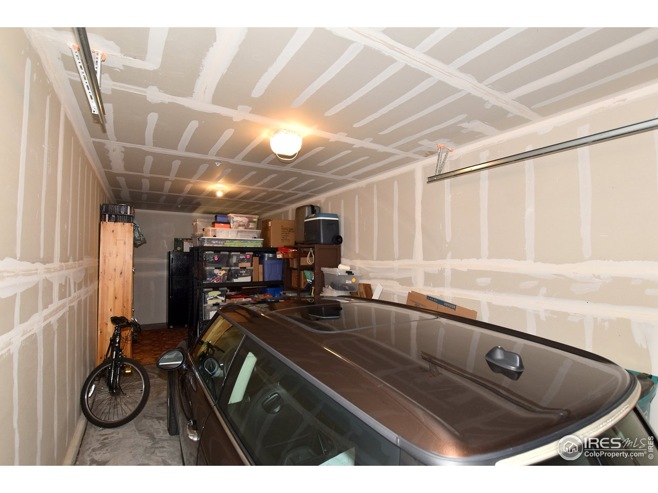 Room for a car, bikes and plenty of storage towards front section! Only 2 garages this size in building, were a premium upgrade!